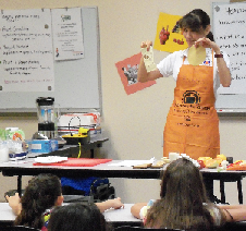 Educator showing classroom slices of cheese